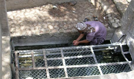 Figure 15 - A workers Alpiedar, of Falaj SAROOJ the water is used for drinking picture was taken in 2005